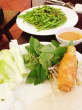Close up of the sugar cane and a watercress-type dish with tofu (i think?)